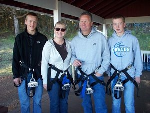 Image of Mrs. Collin with family, ready to zipline