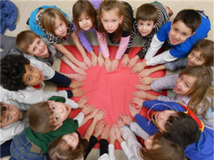 Kids with hands in the shape of a heart